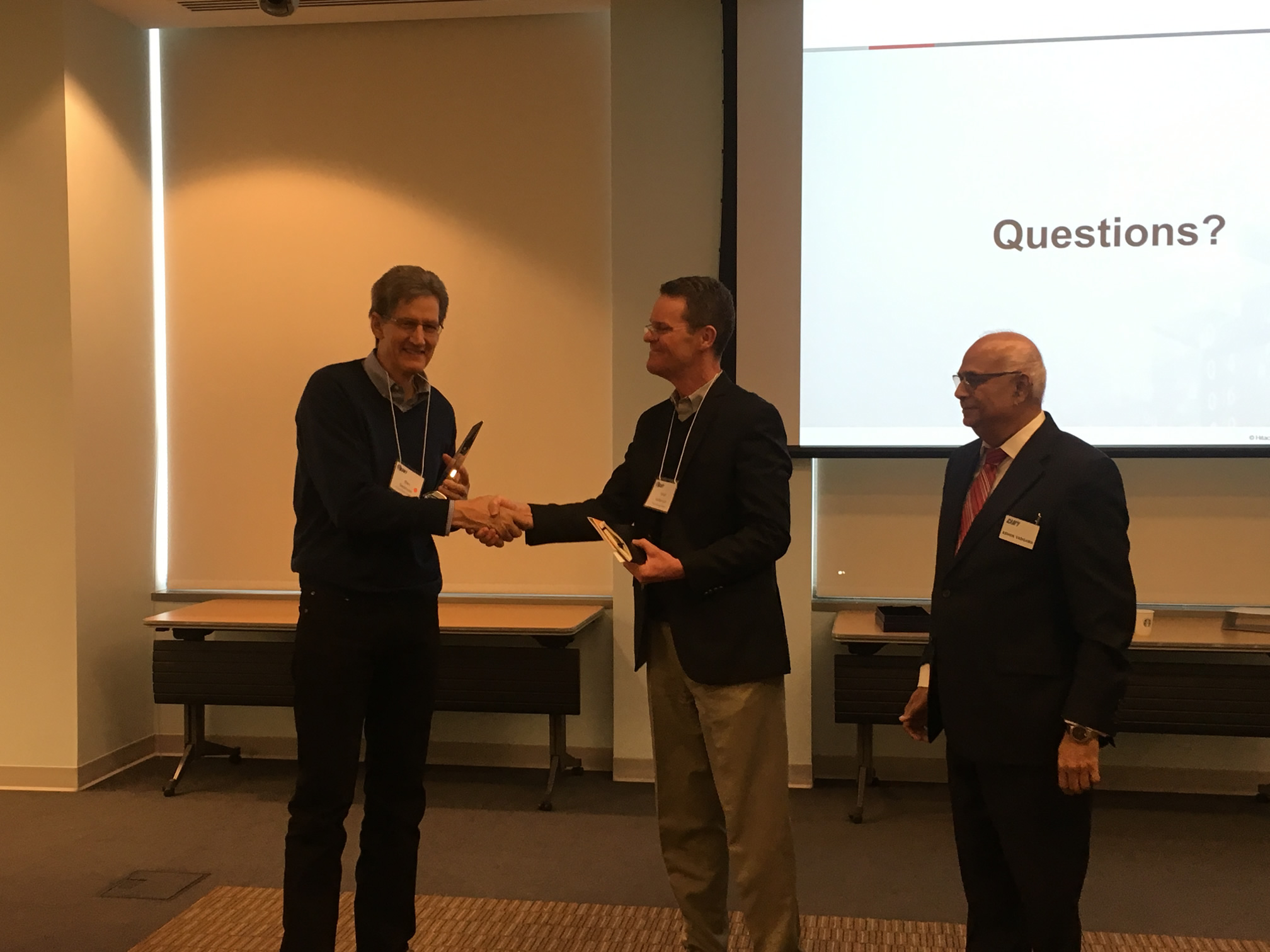 Dan Swenson (Arizona State University) on the left receiving award from Matt Anderson (The Boeing Company) on the right Ashok Vadgama (CAM-I President)