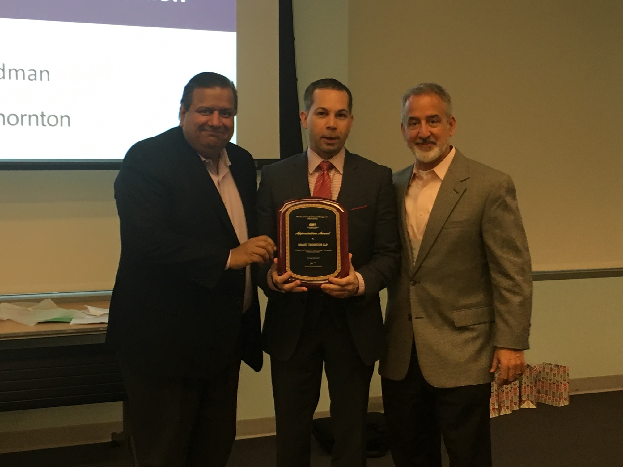 Anthony Scardino (USPTO) in the middle who presented the award to Srikant Sastry (Grant Thornton LLP) on the left with Carlos A. Otal (Grant Thornton LLP) on the right.